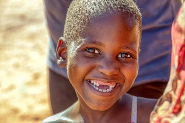 portrait of an african child in a village near Kalahari desert,