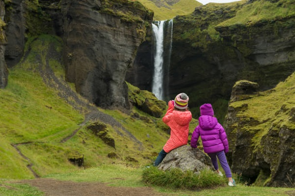 Sisters hiking to an incredible waterfall in Iceland